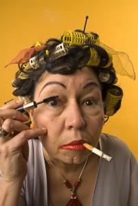 old woman applying makeup